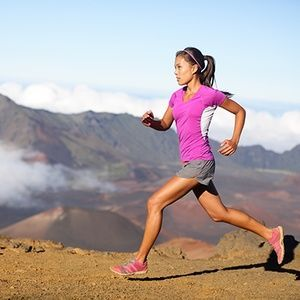 A woman running through the mountains after chiropractic care from Tracy Chiropractic in Tracy, CA