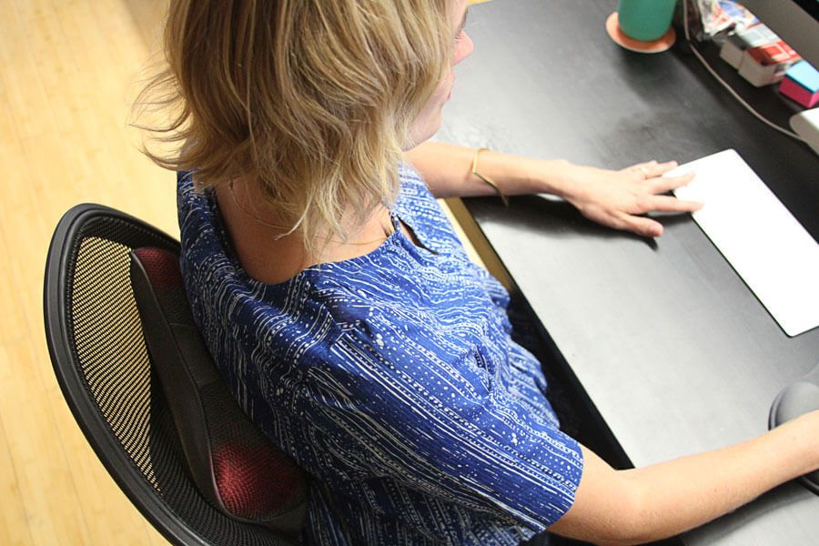A back massager being used in the office